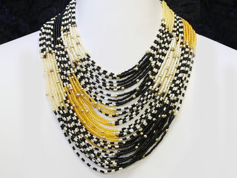 Black, cream with fancy bead accents
