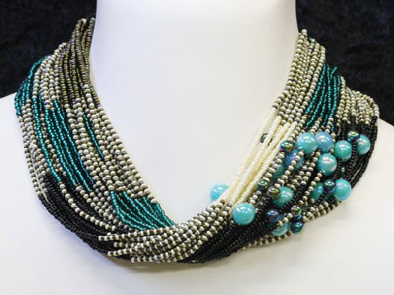 Black, cream , turquoise with fancy accent beads