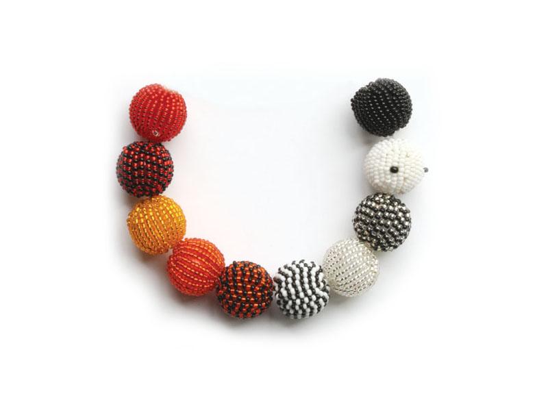 Black, white and reds and orange